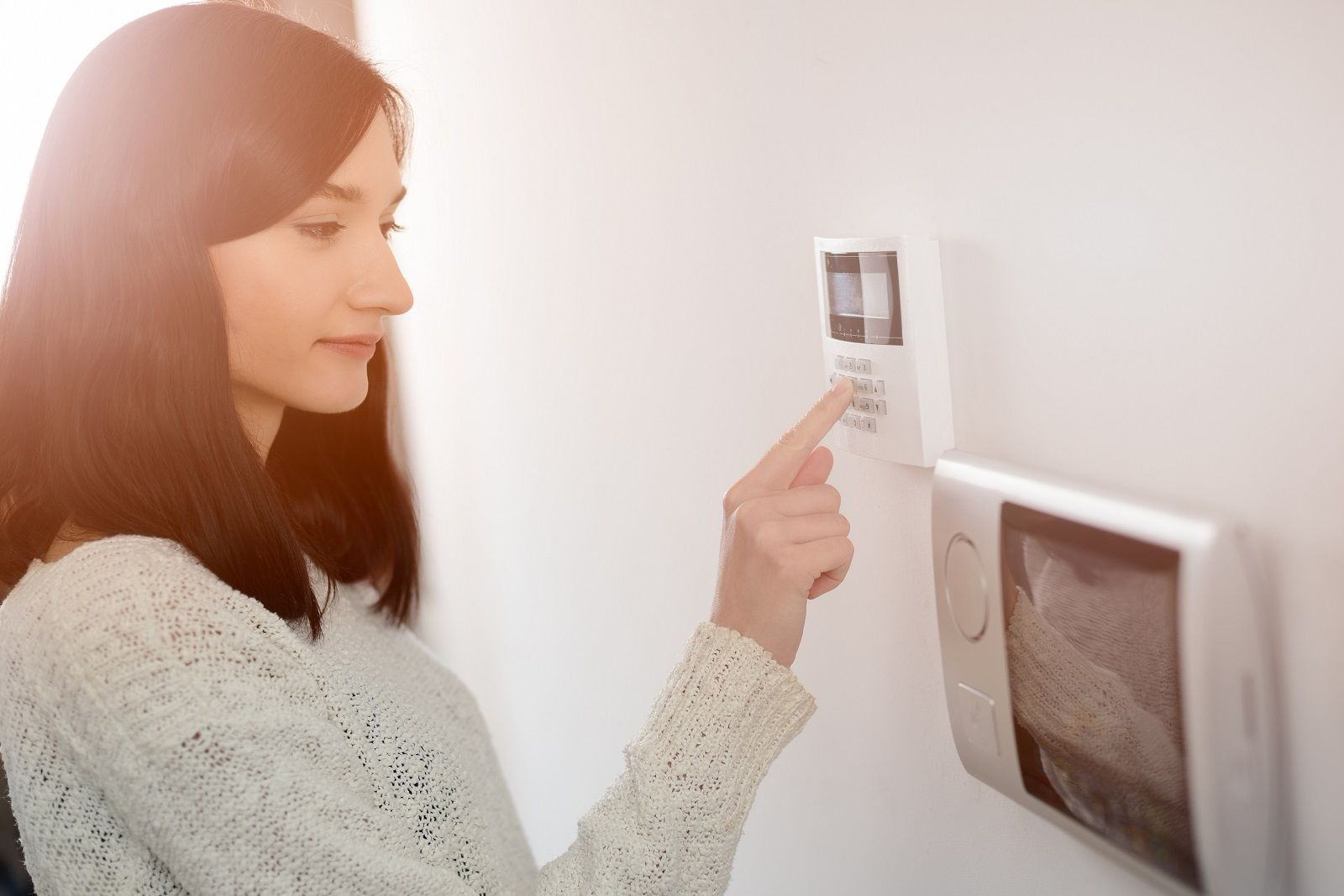 girl using security alarm